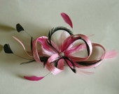 Small pink and black sinamay hat clip