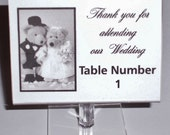 10 individual Free Standing clear favor frames for all your Wedding place cards or table numbers