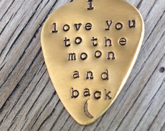Hand stamped brass guitar pick- love you to the moon and back- ready to ship