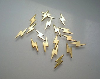 18 tiny flat brass lightning bolts