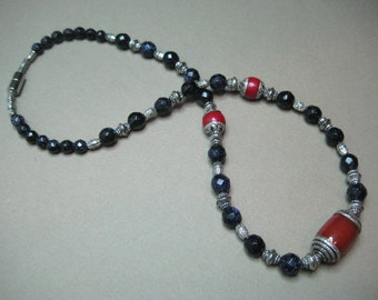 Glittering Galaxy Sun Sitara faceted bead necklace with Tibetan Crafted Red Agate Focal Bead