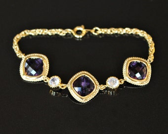 Faceted Amethyst Crystals and Cubic Zirconia Set in Gold on a Gold Link Bracelet