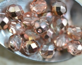 Apollo gold round faceted Czech glass beads 4mm (50) Item 2096