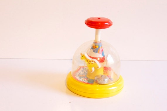 Reserved Vintage 1980s Tomy Push'n Merry Go Zoo Toy
