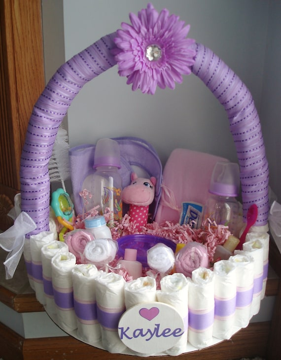 Purple and pink personalized diaper basket by teresaphillips for Baby shower decoration ideas with diapers