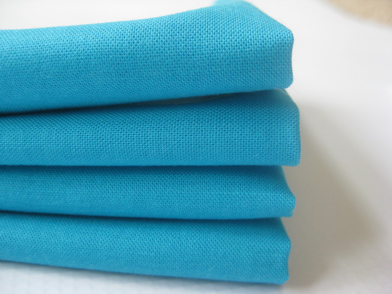ʺW × 32ʺD × ʺH Set of twelve teal French hand-embroidered napkins. Large, dinner size in patterned damask. Newly hand-dyed with organic vegetable dye in Provence. Dyed in small batches, rinsed with lavender water, starched and ironed.