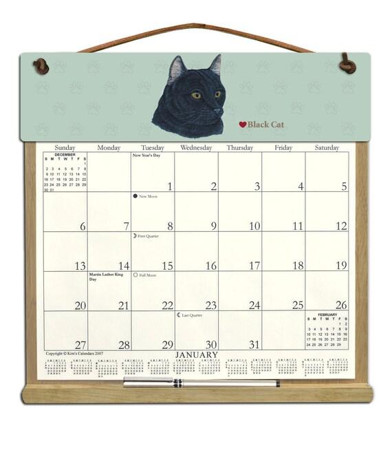 Calendar Wooden Holder : Calendar black cat wooden holder filled with a