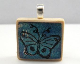 Blue whimsical butterfly - Glowing metallic Scrabble tile pendant