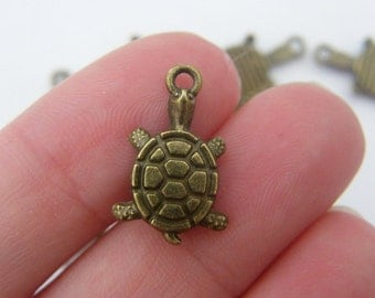 10 Tortoise charms antique bronze tone BC40