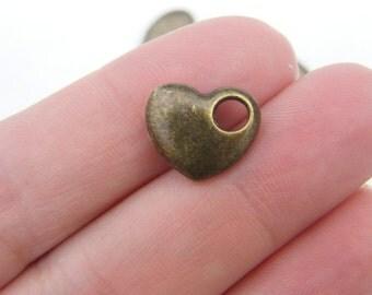 6 Heart charms antique bronze tone BC107