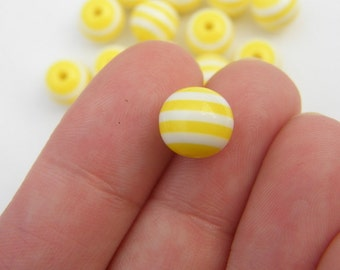100 Yellow and white striped resin beads B101