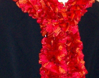 Classy Ruffled Ribbon Scarf in the orange red colors of fire