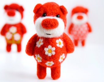 Bright red felted miniature pocket bear with cammomiles