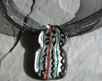 silver glass squiggle lines pendant on black mesh neckcord