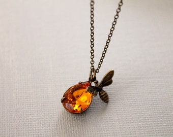 Honey Drop Necklace. Topaz Jewel with tiny ox brass bumble bee charm