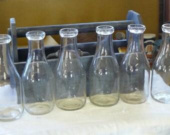 6 vintage one quart milk bottles