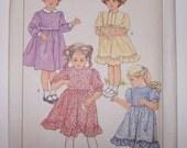 Little girl dress vintage sewing pattern Simplicity 6772 complete uncut size 4
