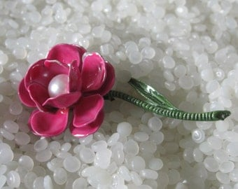 bright pink with a large pearl center brooch