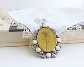 Flower Pendant Necklace in Mustard Yellow, Ivory, and Pewter