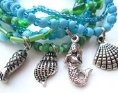 beach charm stretch bracelet set of 7 in aqua teal blue, green, and silver in flip flop gift box