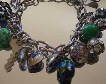 Vintage Upcycled OOAK Charm Bracelet: Rhinestones, Green Silver, Foil Art Glass, Key, Puffy Heart Flowers