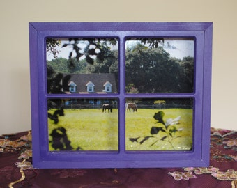 Ranch house with horses in purple window frame