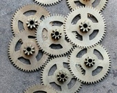 Vintage clock brass gears -- set of 9 -- D15