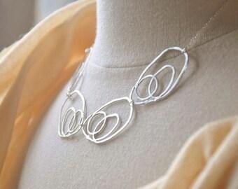 Sterling Silver Modern Swirls Bib Necklace - Contemporary, Unique Design
