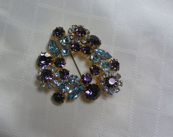 Vintage Made in Austria Blue and Amethyst Marquis Cut and Baguettes and Round Rhinestone Wreath with off set Flowers Brooch or Pendant