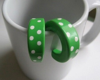 vintage green plastic earrings with white polka dots