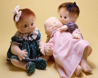 Baby Love, life size doll and her clothing shown, easy to sew doll pattern from Carolee Creations. SewSweet Dolls