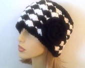 RESERVED --- Black and White Cloche Hat with Black Flower