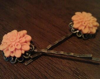 Orange and antique brass hair grips