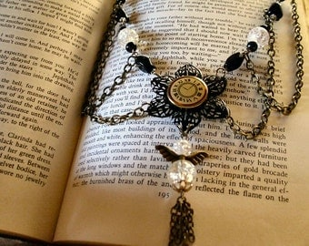 Crystal angel charm and vintage time button on a black filigree flower beaded necklace