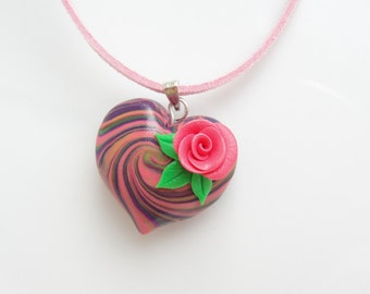Valentine's heart necklace with rose detail in pink, purple and green colours handmade from polymer clay