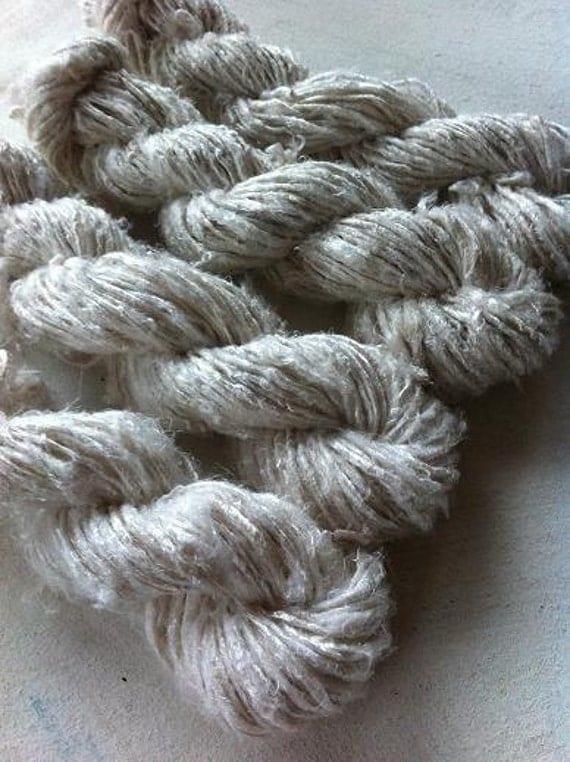 White undyed handspun banana silk yarn. Art yarn. Knitting yarn. Fibre art supplies. Unique handmade yarn supplies.