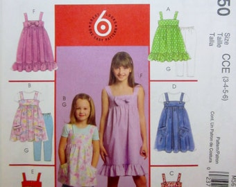 McCalls 5650 Girls Tops Dress and Leggings Sewing Pattern Breast 22 to 25 Size 3 to 6
