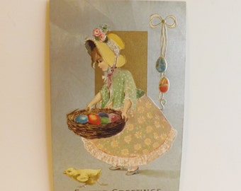 Antique Easter postcard Edwardian little girl in bonnet holding nest of eggs with chick