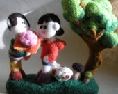 A wool needle felted sculpture, the young cute couple under the tree...