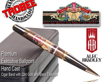 The perfect cigar gift. Executive ballpoint pen featuring the label of Alec Bradley. Gold and black titanium.