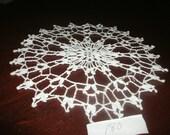 Small decorative lace doily.