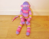 Pastel sock monkey with purple, pink, and green stripes - Easter