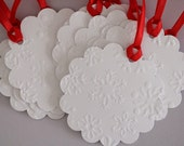 Snowflakes embossed tags. Perfect for the holidays.