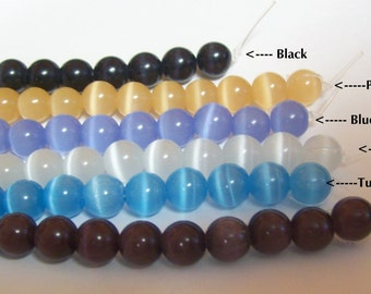 2 matching 7 inch strands 8mm Cats Eye Glass Beads ...