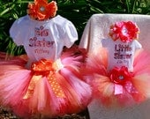 Big Sister  and Little Sister personalized embroidered shirts with matching  sunset tutus and headband.