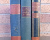 Vintage collection of three large old books in blue and red