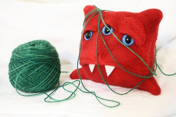 3-eyed derpy monster in orange fleece