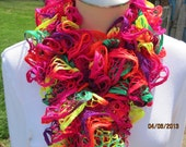 Ruffle scarf hand knitted with Premier Starbella lacy ribbon yarn in multiple bright colors