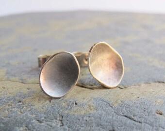 Simple silver stud earrings- Sterling silver pebble shaped stud earrings