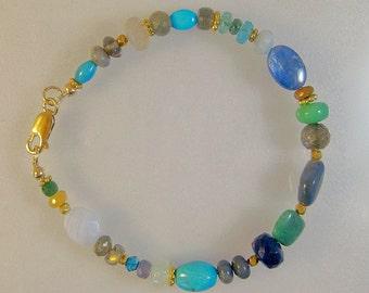 Multigem sparkling green and blue bracelet: charity donation